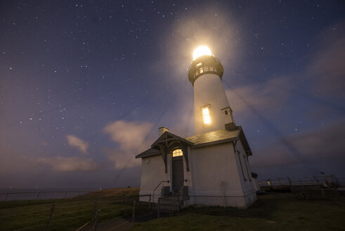 Low angle majestic view of illuminated lighthouse against star field at Cape Blanco State Park - CAVF50952