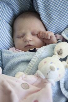 Portrait of sleeping baby girl with toy bunny - JLOF00245