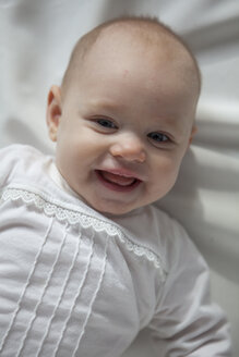 Portrait of smiling baby girl - JLOF00260