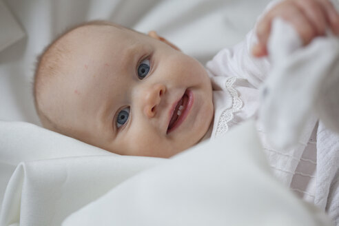 Portrait of smiling baby girl - JLOF00266