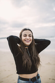 Portrait of happy young woman on the beach - RAEF02201