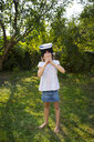 Little girl wearing Virtual Reality Glasses in the garden - LVF07491