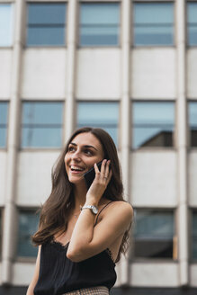 Portrait of smiling young woman on the phone - KKAF02825