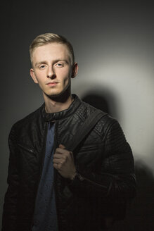 Portrait of young man wearing black leather jacket - VGF00078