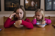 Sisters having breakfast at table - CAVF51438