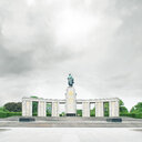 A deserted statue situated in Berlin under a cloudy sky - INGF03548