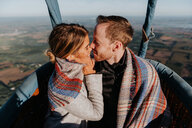 Newly engaged couple in hot air balloon - CUF46334
