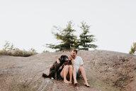 Couple with pet dog, Algonquin Park, Canada - CUF46352
