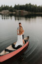 Couple standing on boat, Algonquin Park, Canada - CUF46364
