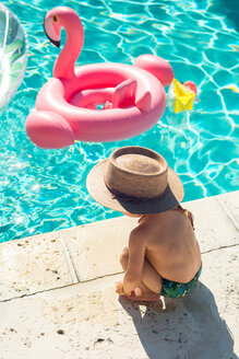 Toddler at swimming pool in summer - CUF46376