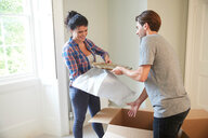 Couple packing belongings into cardboard box - CUF46520