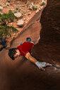 Man trad climbing, Indian Creek, Moab, Utah, USA - ISF20018