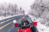Touring motorcycle parked on roadside in winter, Placerville, California, USA - ISF20030