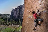 Man rock climbing, Smith Rock State Park, Oregon, USA - ISF20033