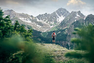 Hiker on mountain peak, Mount Sneffels, Ouray, Colorado, USA - ISF20099