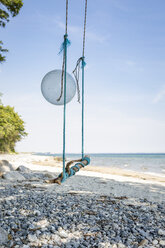 Swing with a balloon at the beach - OJF00284