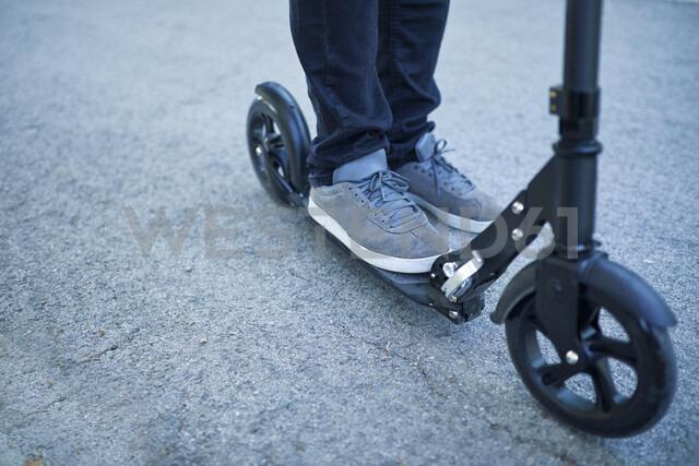 Man's feet on scooter - ZEDF01690
