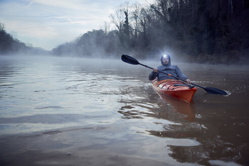 Man kayaking on Chattahoochee River against sky - CAVF51804