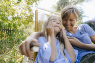 Mother and daughter having fun in garden - KNSF05094