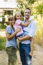 Portrait of happy family in garden - KNSF05112