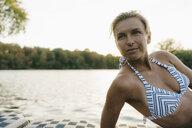 Portrait of woman wearing a bikini at a lake - KNSF05142