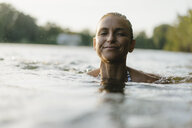 Portrait of smiling woman swimming in a lake - KNSF05166