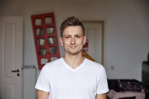 Portrait of smiling young man at home - RHF02199