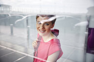 Portrait of smiling woman at the airport - RHF02211