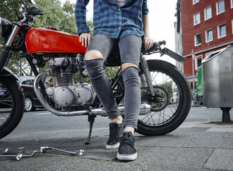 Close-up of young woman on motorcycle - RHF02376