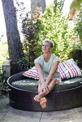 Portrait of woman relaxing in the garden - BFRF01920