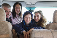 Portrait happy family in motor home - HOXF03978