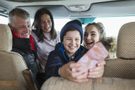 Happy family with smart phone in motor home - HOXF04023