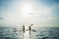 Women in clear bottom canoe on sunny, idyllic ocean, Maldives, Indian Ocean - HOXF04176