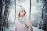 Portrait of a young woman in the snow during winter - INGF05239