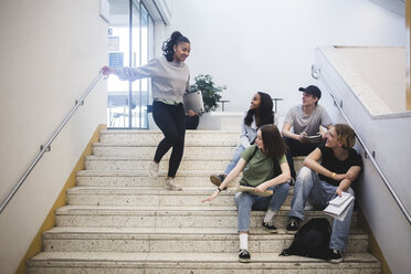 Smiling multi-ethnic students on staircase in high school - MASF09312