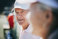 Close-up of senior man with friend at tennis court - MASF09483