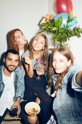 Portrait of happy young multi-ethnic friends enjoying party at apartment - MASF09603