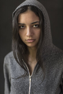 Portrait of confident young woman wearing hooded shirt - TGBF00356