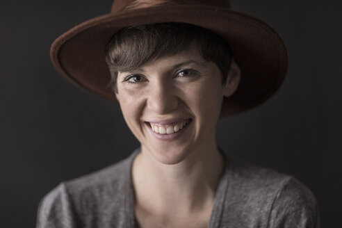Portrait of happy young woman wearing hat - TGBF00365