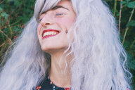 Young woman with white hair is smiling - INGF05352