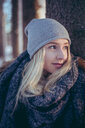 Portrait of young woman with blonde hair in winter - INGF05391