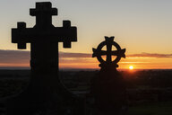 United Kingdom, England, Old Sodbury, Church of Saint John the Baptist, grave yard, crosses at sunset - ALRF01352