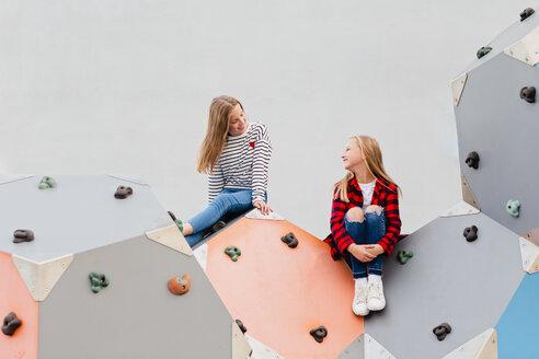 Two smiling girls in climbing gym - NMSF00283