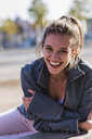 Portrait of laughing young woman outdoors - UUF15743