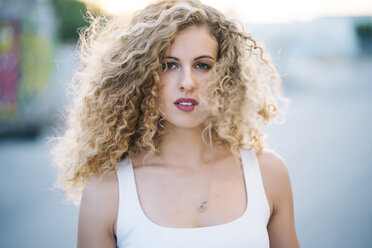 Portrait of blond young woman with blowing hair - OCMF00011