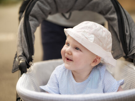 Portrait of relaxed baby girl in pram - LAF02125