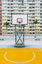 China, Hong Kong, Kowloon, basketball hoop, public housing in the background - GEMF02441