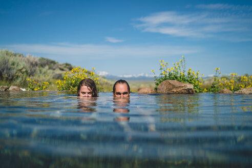 Young Couple Swimming In Lake - TGBF00952