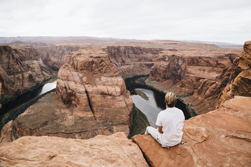 Young man admiring the view from above at Colorado River - TGBF01018