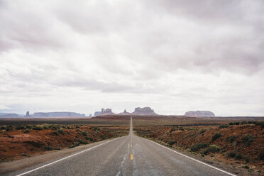 Empty desert highway leading into Monument Valley - TGBF01021